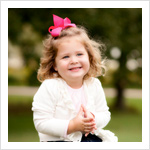 Outdoor portrait of a 3-year-old girl outside at Veteran Acres in Crystal Lake, IL.
